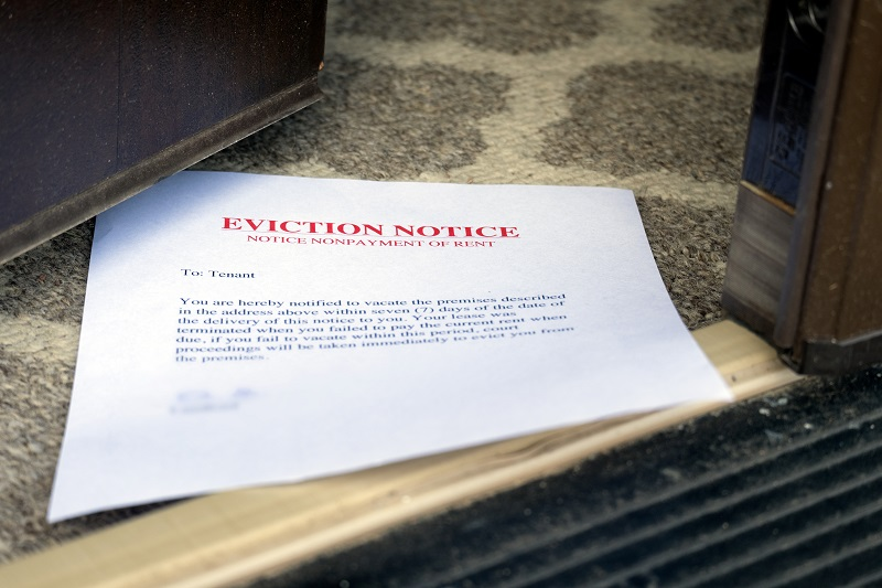 EVICTION NOTICE (ON THE FLOOR) SLIPPED UNDER OPENED ENTRANCE DOOR